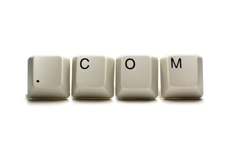 short phrase: .com written with computer keys, isolated on white