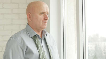 Upset Businessman Image in Office Room, Disappointed Businessperson Looking Out of His Office Window
