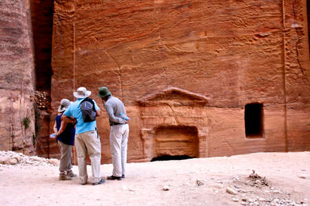 PETRA, JORDAN - DECEMBER 8 : Tourists observing the historical remains on Dec 8, 2009 in Petra, Jordan.  Stock Photo - 12690611