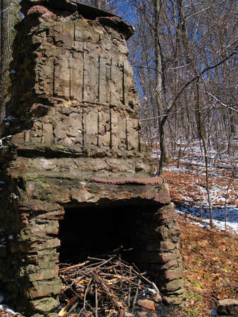 outdoor fireplace: An old chimney, fireplace, left standing where a homestead used to be.