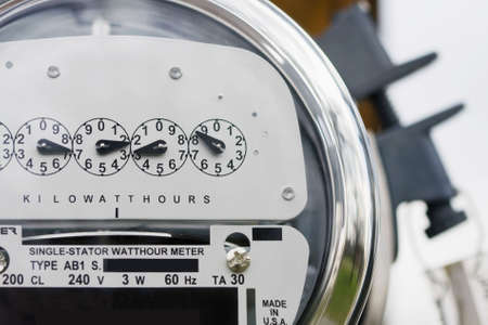 power meter: Close-up of an electric meter with lock in background.