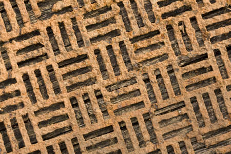 metal grate: Close-up of an old decorative rusty metal grate. Stock Photo