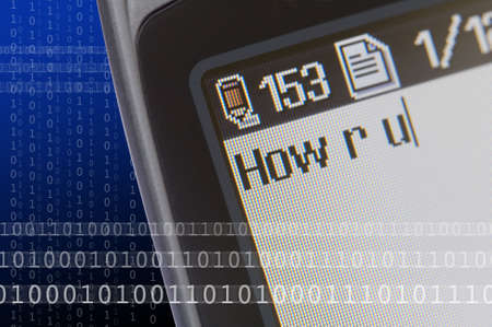 Closeup of a mobile phone messaging menu with text message selected.