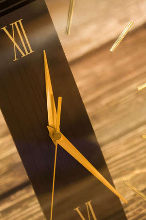 Close-up of a gold and brown quartz clock with roman numerals. Stock Photo - 3140136