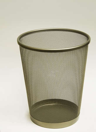 wire mesh: An empty wire mesh trash container for the home or office.