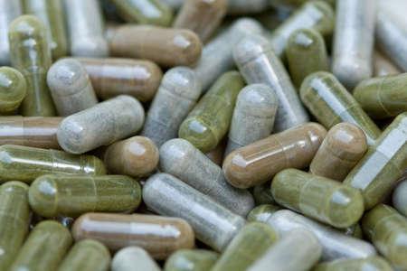 Macro shot of a variety of herbal medicine capsules. 版權商用圖片