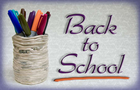 Back to School type (public domain free type) with pens and ceramic holder. Stock Photo - 3293890