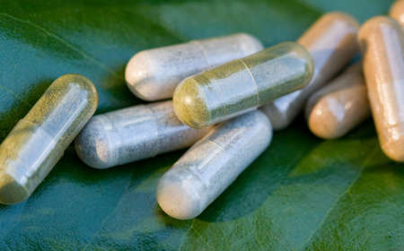 Close-up of a variety of herbal medicine capsules Stock Photo
