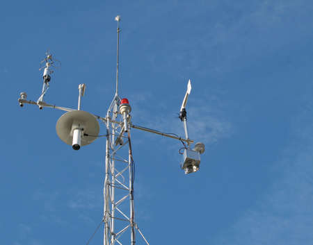 weather gauge: View of weather station with various meteorology measurement devices. Stock Photo