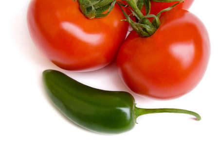 jalapeno pepper: Fresh tomatoes and jalapeno pepper isolated on white.