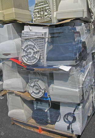 Computer monitors stacked on a shipping palette ready to be recycled. photo