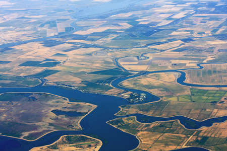 irrigated: Aerial view of agriculture land with lakes and streams for irrigation.
