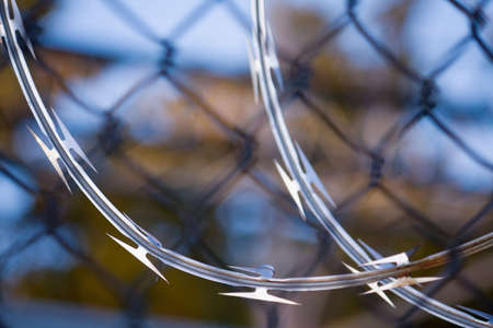 Close-up of razor wire with fence background. Stock Photo - 5816428