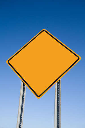road warning sign: Blank Caution sign with blue sky background. Stock Photo