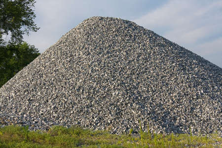Pile of gravel outdoors with nature background. photo