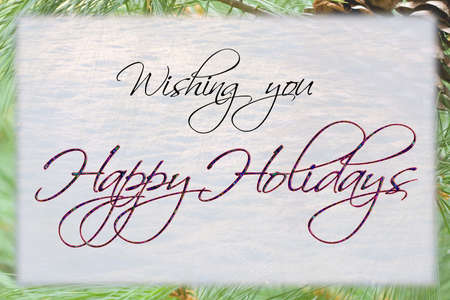 festive: Happy Holidays card with snow and pine background