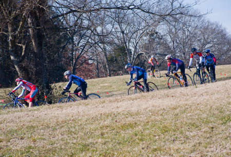 KNOXVILLE - JANUARY 22: Cyclers from various teams compete during the Knoxiecross cyclocross series, January 22, 2011, Victor Ashe Park, Knoxville, Tennessee. Editöryel