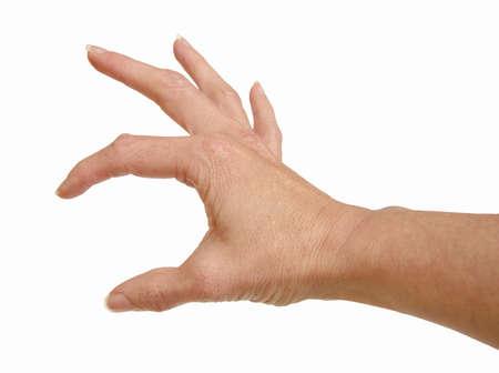 Vrouwelijke menselijke hand met vingers houden iets Stockfoto