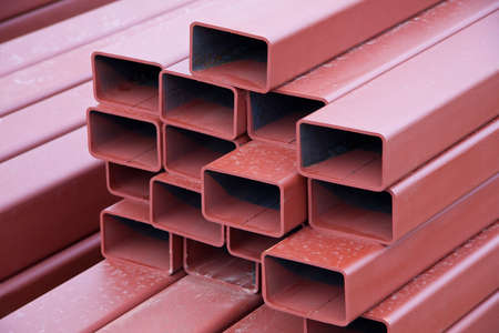 paint box: A stack of painted steel box girders used in construction Stock Photo