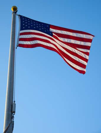 American flag waving in the wind viewed from below photo
