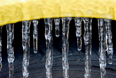 frigid: Icicles form on the wheel well of a car from an ice storm