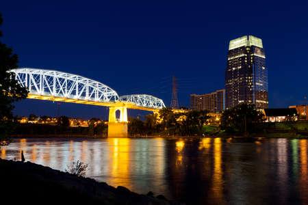 Nashville, Tennessee bridge and city skyline at dusk photo