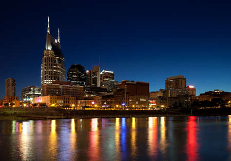 Nashville, Tennessee city skyline at dusk with reflection