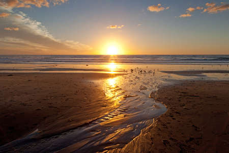 Beautiful sunset on the beach at Carlsbad, California photo