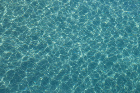 Blue green ocean water background with ripples