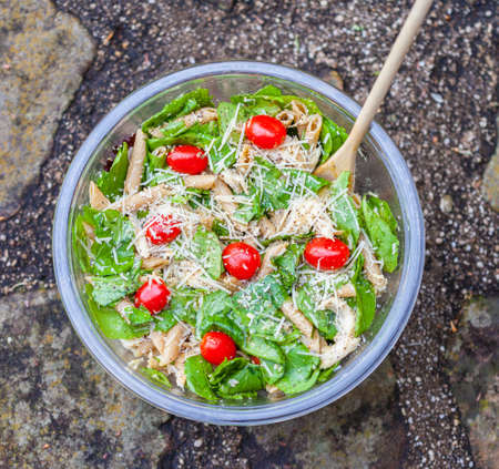Large bowl of chicken pasta caesar salad photo