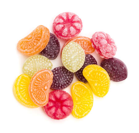 hard candy: An assortment of fruit flavored hard candy on a white background