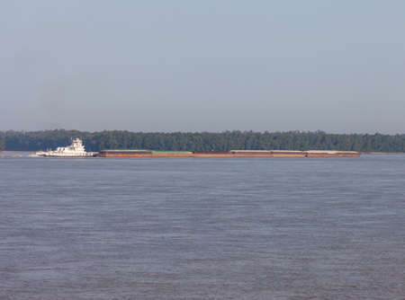 A towboat and barge moving goods on the Mississippi River Stok Fotoğraf