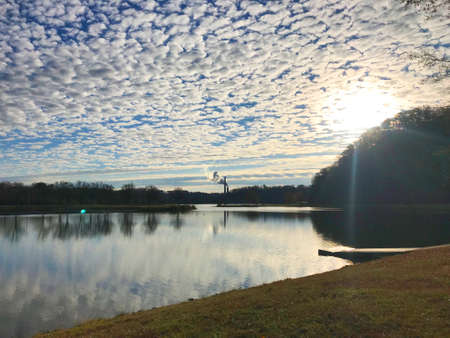 View of Oak Ridge Marina bay with fluffy clouds and fall colors in Oak Ridge, Tennessee. Stok Fotoğraf