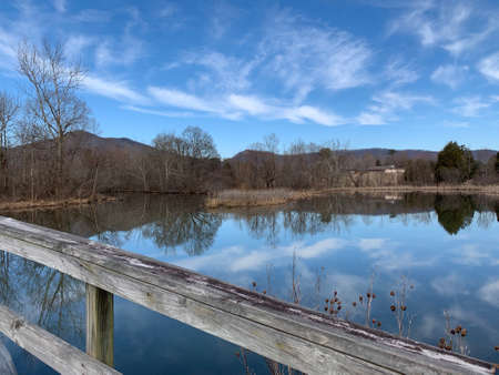 A view from the greenway at Cove Lake State Park, Caryville, Tennessee in winter with blue sky and clouds.