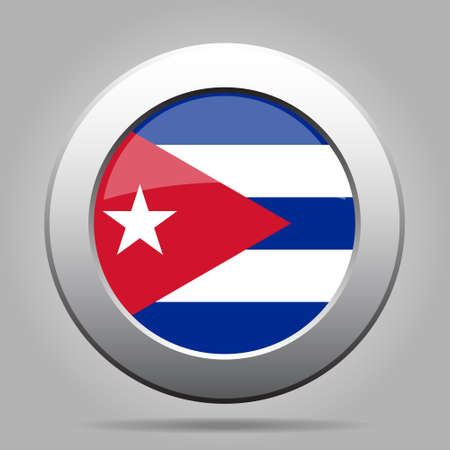 totalitarian: metal button with the national flag of Cuba on a gray background