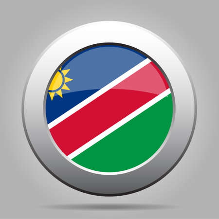 metal button: metal button with the national flag of Namibia on a gray background