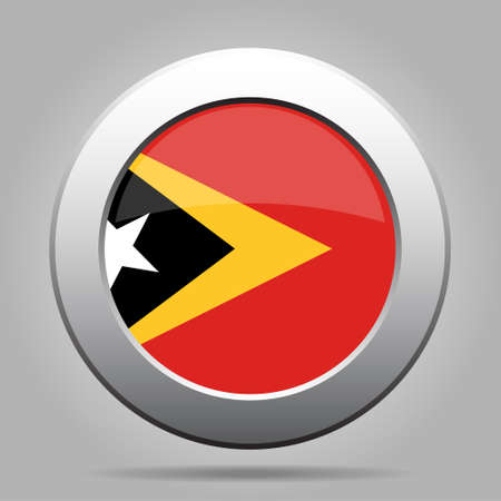 metal button: National flag of East Timor. Shiny metal gray round button with shadow.