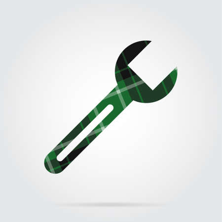 Green, black isolated tartan icon with white stripes - spanner and shadow in front of a gray background