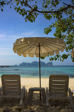 umbrela: Relax and enjoy your vacation with summer, beach and sea (picture from Phi Phi Island - Thailand)