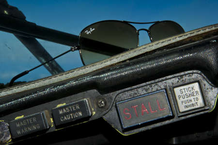 DELHI, INDIA - JULY 3: Ray-Ban partners with Radio One to celebrate its 75th�anniversary. Ray-Ban sunglasses on the dashboard of an old airplane overflying Delhi, India on july 3.