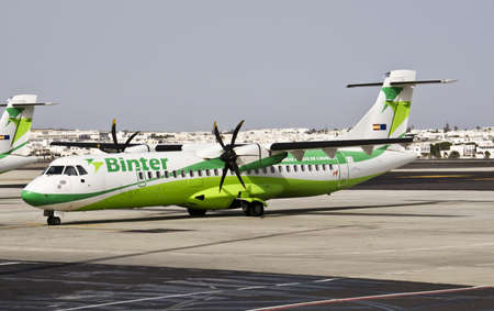 canarias: LANZAROTE, CANARY ISLANDS, SPAIN - JULY 15: Binter Canarias is the best airline in Spain and the eleventh in the world for eDreams. A Binter Canarias aircraft at the Lanzarote Airport on July 17, 2012 in Lanzarote, , Canary Islands, Spain.