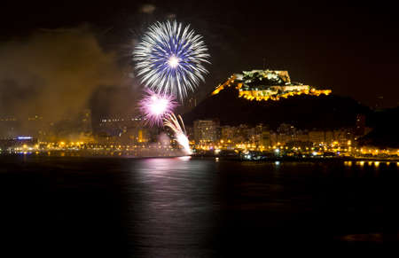 Fireworks during the night on the beach Alicante - Spain  photo