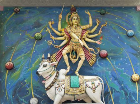 Indian God Statue with Cow at the Temple photo