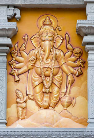 Orange Elephant God Relief Engraved on the Wall photo
