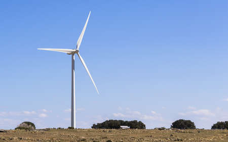 aero generator: Windmill on top of an isolated hill Stock Photo