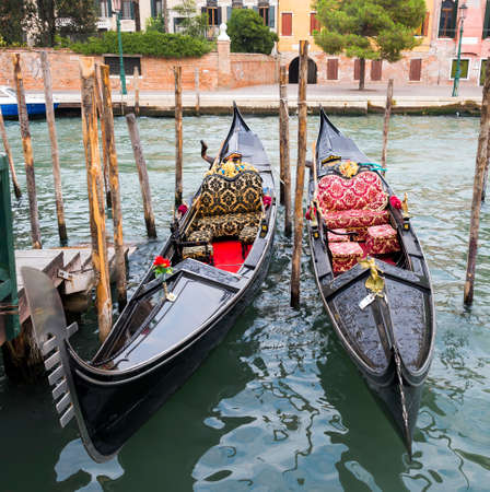 Two Gondolas in the Venice Channels in Italy photo