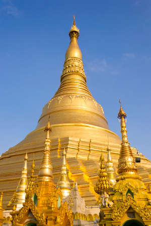 Shwedagon golden pagoda with a blue sky in Rangoon, Myanmar photo