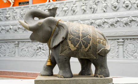 Statue of an Elephant outside of an hindu temple photo