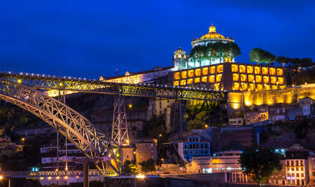 Porto old center by the Douro river with bridge by night photo