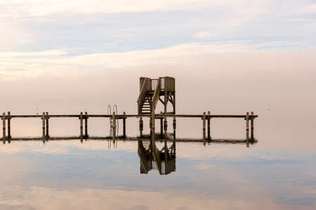 Wooden Dock in the Middle of the Water during Winter Season photo